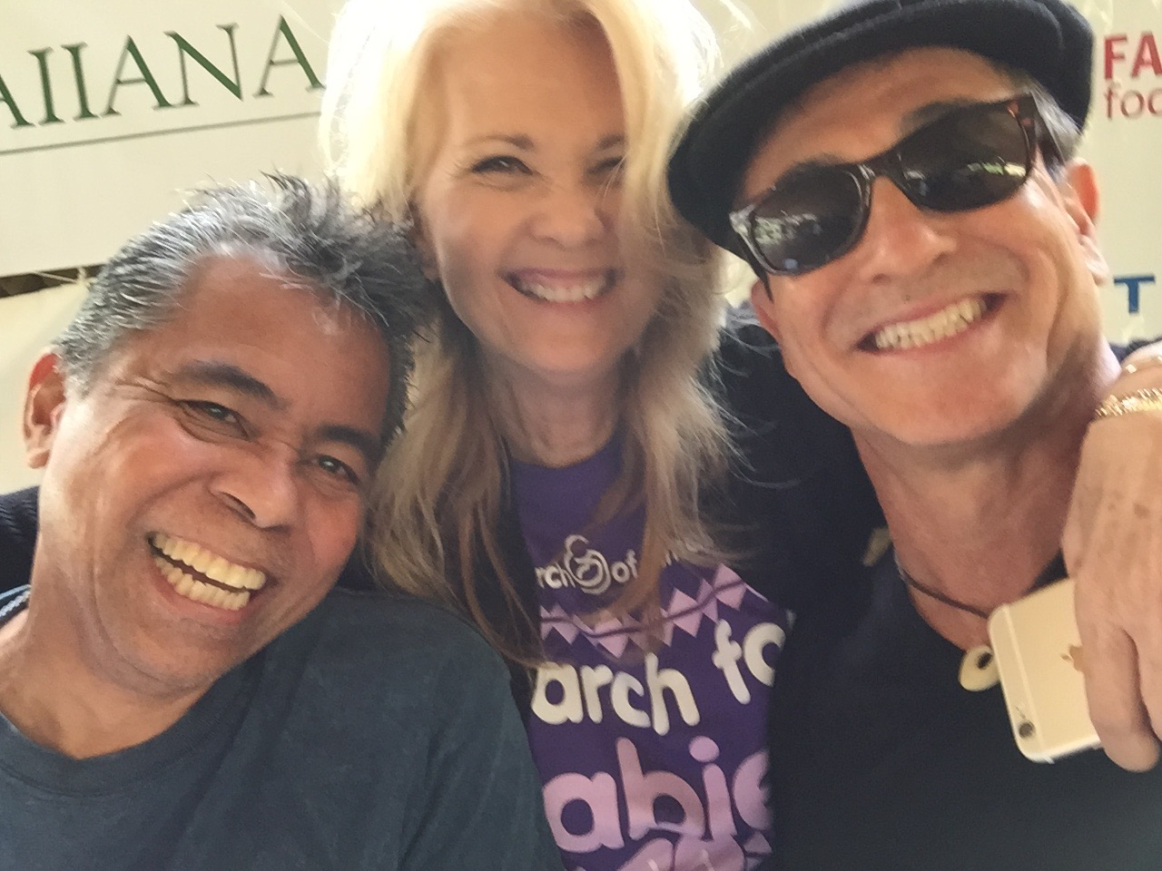 Radio Personality Ed Kanoe, Pacific Region Director of March of Dimes, Carmella Hernandez and Mike Dandurand of Kustom Sounds Kauai